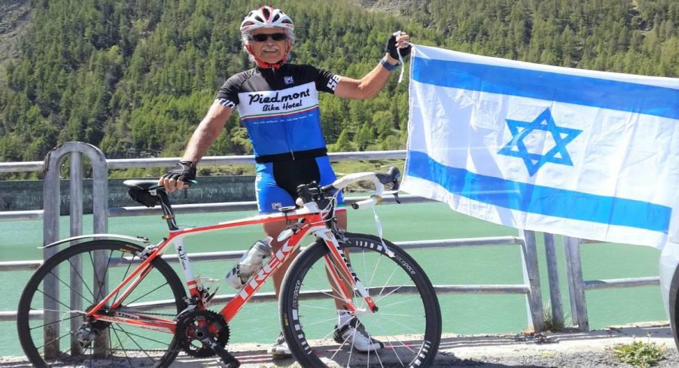 ג'קי בן שמחון על אופניו ועם דגל ישראל
